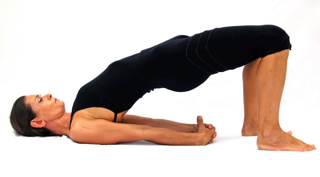 Setu bandha sarvangasana half bridge pose Sukhabalasana Opale Yoga Ibiza