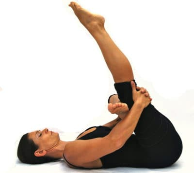 Sucirandrasana eye of the needle pose with extended leg Opale Yoga Ibiza