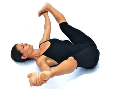 Supta prasarita padottanasana reclined wide leg stretched out pose Opale Yoga Ibiza