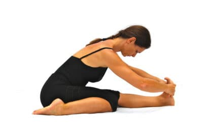 Tryanga mukaikapada pascimottanasana 3 limbs touching face to 1 leg back stretched out pose Opale Yoga Ibiza
