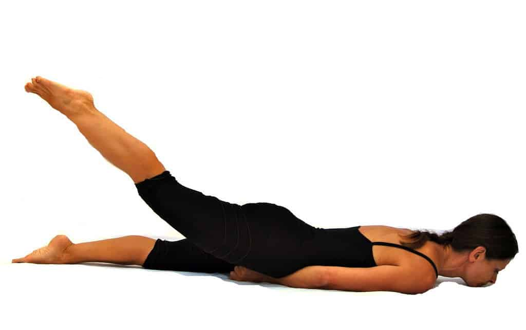 Viparita Salabhasana inverted locust pose preparation with 1 leg Opale Yoga Ibiza